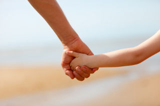 holding hand of child