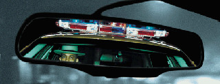police car in rear view mirror